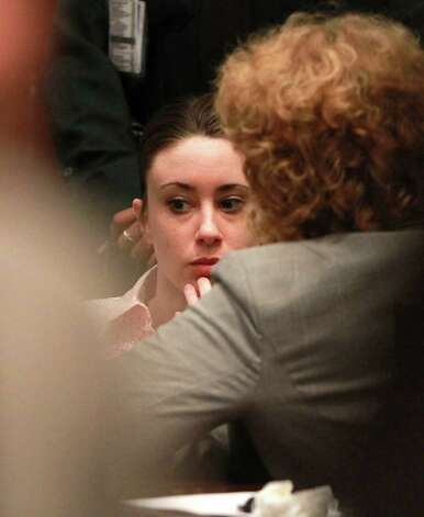 Casey Anthony, left, and one of her attorneys, Dorothy Clay Sims, wait in the courtroom during the second day of jury deliberations in her murder trial in Orlando, Fla. on Tuesday, July 5, 2011. Anthony has plead not guilty to first-degree murder in the death of her daughter, Caylee, and could face the death penalty if convicted of that charge. Photo: AP
