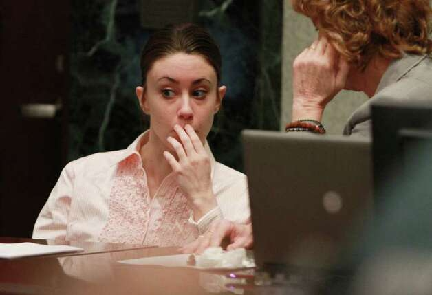Casey Anthony waits in the courtroom with her attorney, Dorothy Clay Sims, right, during the second day of jury deliberations in her murder trial in Orlando, Fla., Tuesday, July 5, 2011. Anthony has plead not guilty to first-degree murder in the death of her daughter, Caylee, and could face the death penalty if convicted of that charge. Photo: AP