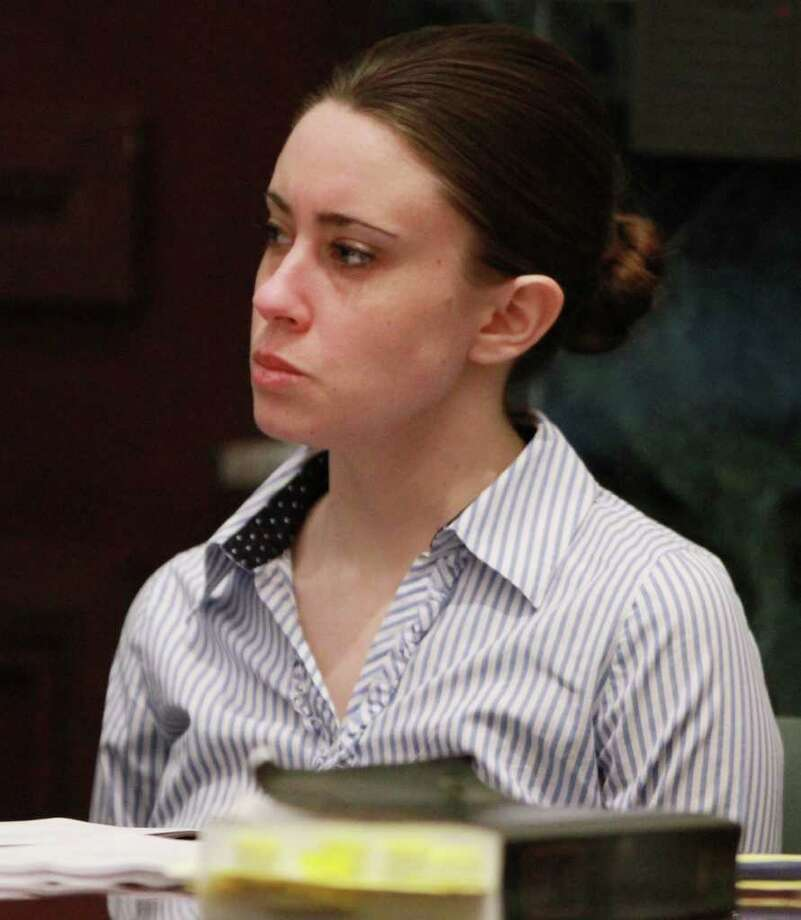 Casey Anthony listens to the judge's instructions to the jury in her murder trial at the Orange County Courthouse in Orlando, Fla. on Monday, July 4, 2011. The jurors are expected to begin their deliberations Monday afternoon. (AP Photo/Joe Burbank, Pool) Photo: Joe Burbank