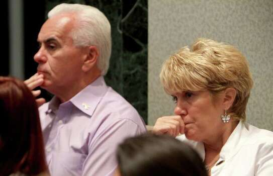 George Anthony, left, and Cindy Anthony, parents of Casey Anthony, listen to Asst. State Attorney Jeff Ashton give the final rebuttal in the Casey Anthony murder trial at the Orange County Courthouse in Orlando, Fla. on Monday, July 4, 2011. Anthony has plead not guilty to first-degree murder in the death of her daughter, Caylee, and could face the death penalty if convicted of that charge.  (AP Photo/Red Huber, Pool) Photo: Red Huber