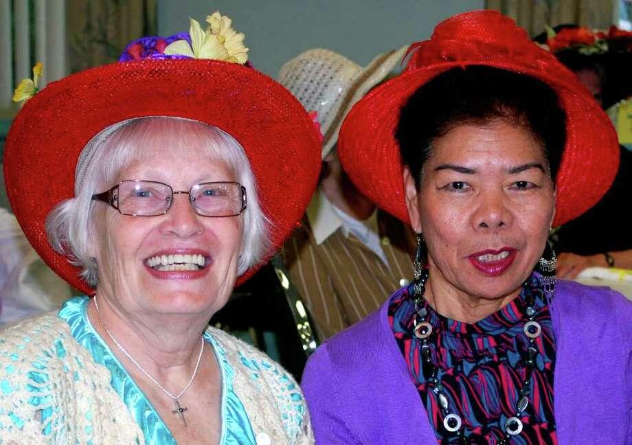 SPECTRUM/Lorna MacInnis, left, and Rosie Marksstaller proudly show off their hats at a ladies' summer hat breakfast June 25, 2011, at the New Milford Senior Center. Photo: Deborah Rose