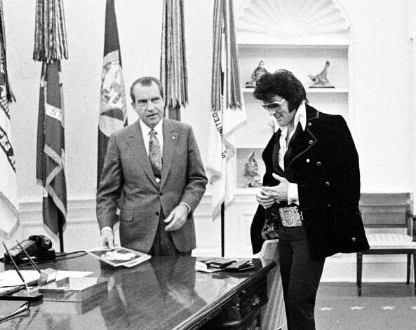 Nixon and Elvis are among the less-likely President-musician combos, but there they are together in the Oval Office on December 21, 1970. Photo: National Archives, Getty Images / Getty Images North America