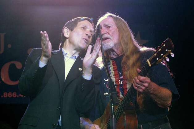 "That would be Willie Nelson, who here sings ""I Saw the Light"" with Kucinich during a fundraiser on January 3, 2004 in Austin, Texas. Photo: Jana Birchum, Getty Images / 2003 Getty Images"