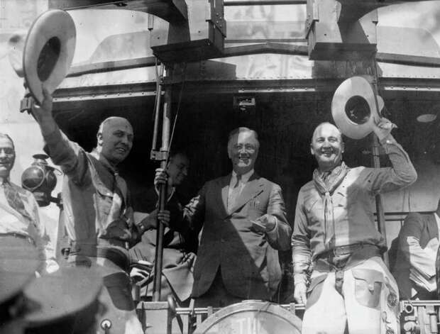 "Franklin D Roosevelt had one of the most-memorable campaign songs, ""Happy Days are Here Again,"" during his 1932 campaign. Here, the then New York governor and presidential candidate campaigns from the back of his train with two cowboys on September 27, 1932 in  Laramie, Wyoming. Photo: Keystone, Getty Images / Hulton Archive"