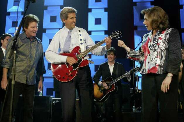 John Fogerty let Kerry play guitar during take this Kerry/Edwards 2004 Victory concert on July 8, 2004 at Radio City Music Hall in New York City. Photo: LUKE FRAZZA, AFP/Getty Images / 2004 AFP