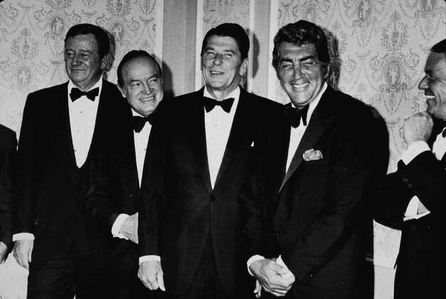 "Ronald Reagan counted many prominent entertainers among his friends and supporters thanks to his decades as a Hollywood actor. Here's then California Gov. Reagan with (from left) John Wayne, Bob Hope (1903 - 2003), Dean Martin and Sinatra at a ""Californians for Reagan"" benefit dinner at the Cocoanut Grove, in Hollywood, on October 10, 1970. Photo: Hulton Archive, Getty Images / 2004 Getty Images"