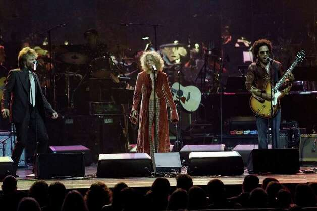 and Jon Bon Jovi (left), Sheryl Crowe (center) and Lenny Kravitz, performing here at the same concert. Photo: LUKE FRAZZA, AFP/Getty Images / AFP