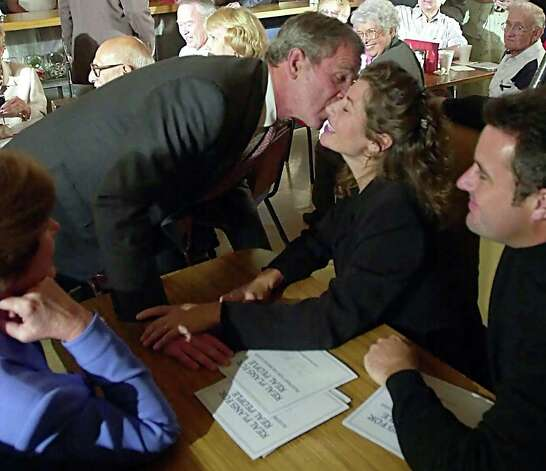 Bush apparently got on well enough with singer Amy Grant to give her a kiss as her husband, country singer Vince Gill (right), looked on during a campaign stop on September 21, 2000 at the Vandyland cafe in Nashville, Tennessee. Republicans tend to do a little better with country singers these days. Photo: TANNEN MAURY, AFP/Getty Images / AFP