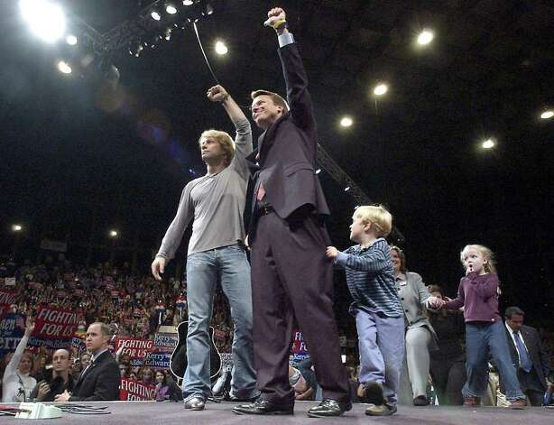Edwards and Jon Bon Jovi and wave to the crowd, while Edwards' son Jack clings to his pants leg and daughter Emma Claire watches with her mother Elizabeth, during a rally on October 29, 2004 in Raleigh, N.C. Photo: Sara Davis, Getty Images / 2004 Getty Images