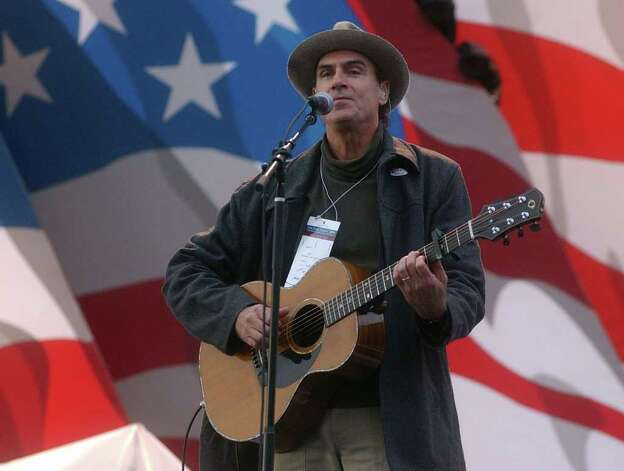 James Taylor rehearses prior to the start of Kerry's election night rally, on November 2, 2004, in Boston. Photo: Darren McCollester, Getty Images / 2004 Getty Images