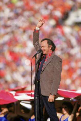 """America,"" Neil Diamond's ode to immigrants, served the 1988 campaign of Democratic nominee Michael Dukakis, a son of Greek immigrants. Photo: George Rose, Getty Images / 1987 Getty Images"