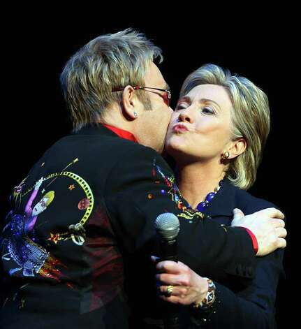 Elton John, another Brit, kisses Clinton during a fund-raiser on April 09, 2008 in New York. Photo: ANDREW THEODORAKIS, AFP/Getty Images / 2008 AFP