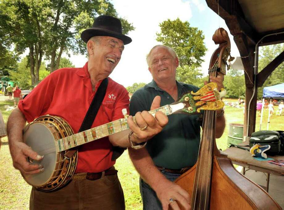 Legendary banjo player Roger Sprung, 80, left, of Newtown, jams with Richard Hawthorne of Wingdale, N.Y., during Pickin' and Fiddlin', in Roxbury, on Sunday, July 11, 2010. Photo: Michael Duffy / The News-Times