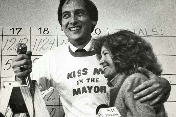 Newly elected Stamford Mayor Thom Serrani hugs his wife, Beth, as they celebrate his victory with supporters at his headquarters at the Glenbrook Community Center in Stamford Nov. 8, 1983.
