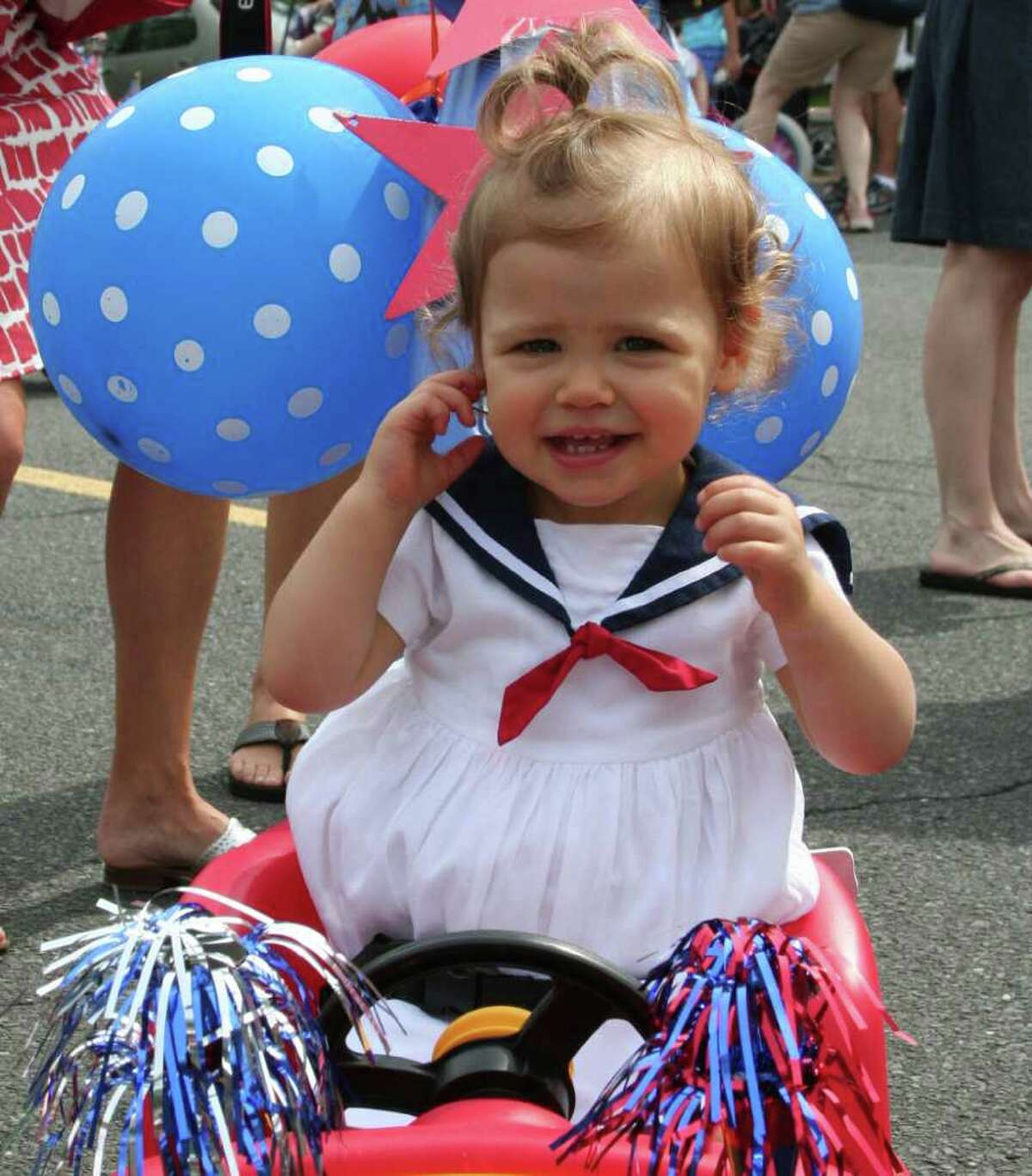 """Georgi Capella smiles from her decorated """"car"""" while waiting for the Push N Pull parade to start last weekend. Photo by Kristen Riolo."""