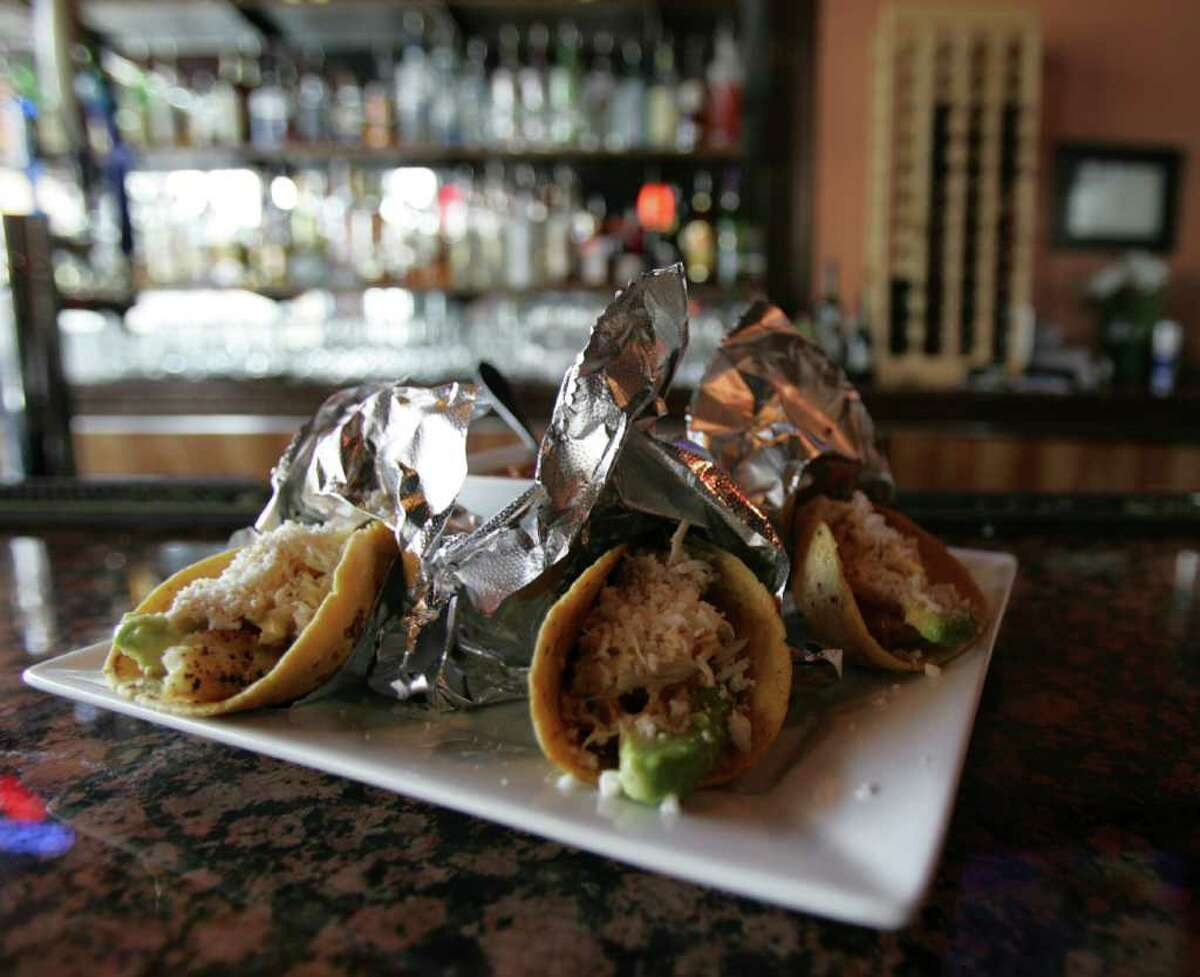 Two types of seafood tacos are available here. Pictured are the ones made with mahi-mahi.