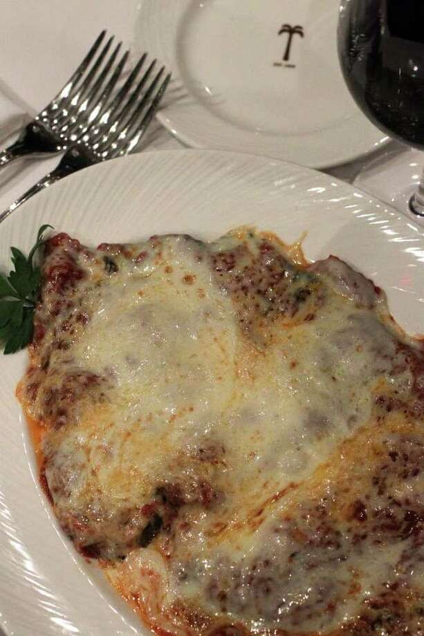 The Veal Parmigiana is served with the king of cheeses -- Parmigiano- Reggiano -- at The Palm Restaurant. Photo: SAN ANTONIO EXPRESS-NEWS