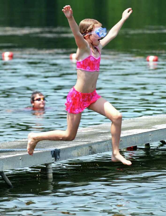 Jenna Lent, 8, of Glenville jumps off the dock at  Collins Park beach in Scotia Tuesday July 5, 2011.   (John Carl D'Annibale / Times Union) Photo: John Carl D'Annibale