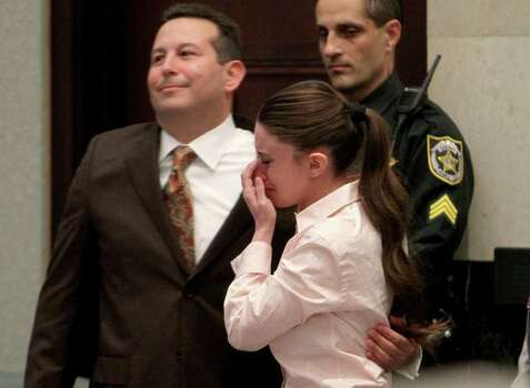 Casey Anthony cries with her attorney Jose Baez, left, after she was acquitted of murder charges of her daughter Caylee at the Orange County Courthouse in Orlando, Florida, Tuesday, July 5, 2011. (Red Huber/Orlando Sentinel/MCT) Photo: Red Huber, MBR / Orlando Sentinel