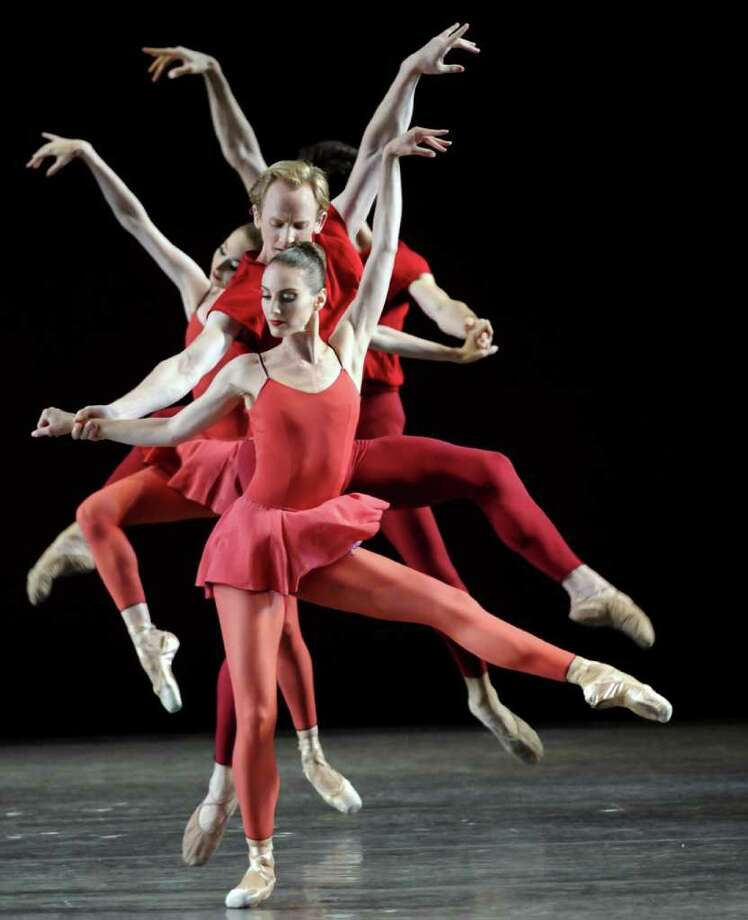 """Members of the New York City Ballet perform the Peter Martins piece """"Fearful,Symmetries"""" to open their season at SPAC in Saratga Springs, NY Tuesday  July 5, 2011. ( Michael P. Farrell/Times Union ) Photo: Michael P. Farrell"""