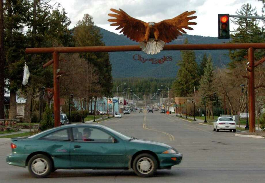 In this April 27, 2011 photo, the entrance to downtown Libby, Mont., is seen. More than 15,000 tons of bark and wood chips potentially contaminated with lethal asbestos have been sold, used in and trucked out the remote town of 3,000 over the past decade. (AP Photo/Matthew Brown) Photo: Matthew Brown