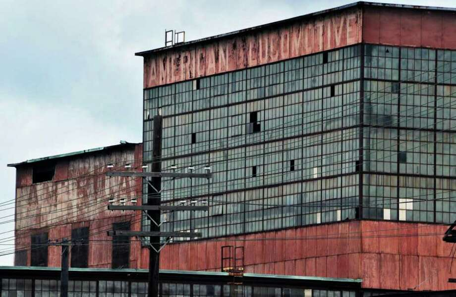 Barely visible is the sign atop the old shop buildings of the American Locomotive company in Schenectady, shown in June 2010. A museum is being planned this spring to showcase the company that existed in the city from 1901 to 1969. (John Carl D'Annibale / Times Union) Photo: John Carl D'Annibale