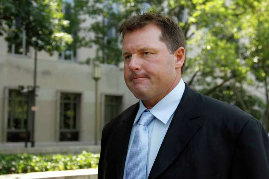 Roger Clemens leaves federal court in Washington, Tuesday, July 5, 2011. (AP Photo/Alex Brandon) Photo: Alex Brandon