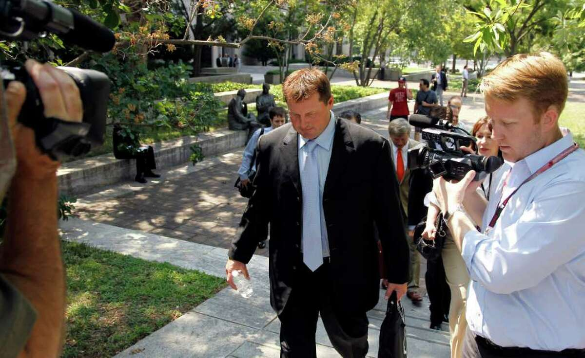 Roger Clemens leaves federal court in Washington, Tuesday, July 5, 2011. (AP Photo/Alex Brandon)