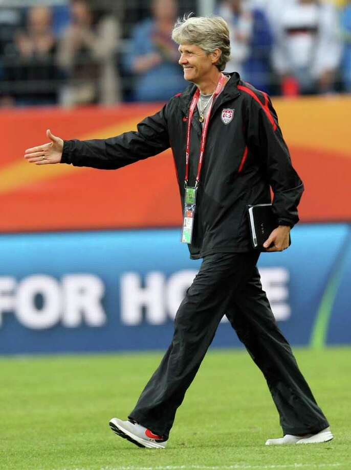 United States team coach Pia Sundhage smiles after winning 3-0 in the group C match between the United States and Colombia at the Women's Soccer World Cup in Sinsheim, Germany, Saturday, July 2, 2011. (AP Photo/Michael Probst) Photo: Michael Probst