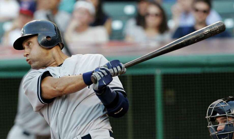 New York Yankees' Derek Jeter watches his two-run double off Cleveland Indians starting pitcher Carlos Carrasco in the second inning in a baseball game Tuesday, July 5, 2011, in Cleveland. (AP Photo/Tony Dejak) Photo: Tony Dejak