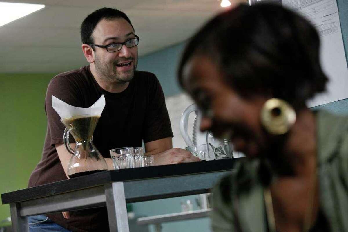 Brown Coffee Co. owner Aaron Blanco laughs with customers including DeeDee Lee.