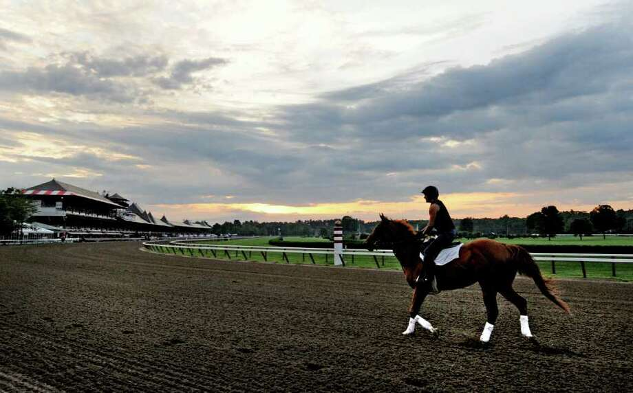 Thoroughbreds take to the main track Wednesday morning on opening day of training at Saratoga Race Course in Saratoga Springs.  (Skip Dickstein /  Times Union) Photo: Skip Dickstein / 2011