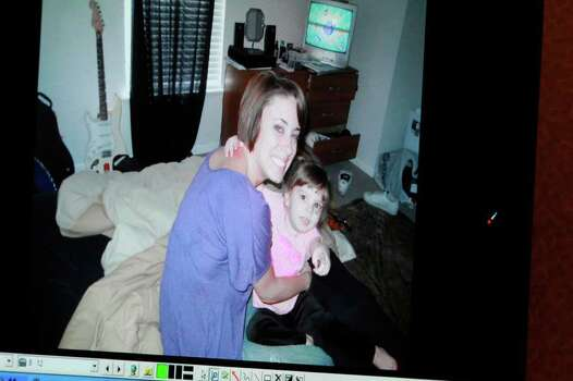 FILE -a photo showing Casey Anthony and her daughter Caylee Anthony that was entered into evidence is seen projected on a courtroom monitor during the Casey Anthony trial at the Orange County Courthouse, Wednesday, June 8, 2011 in Orlando, Fla. Caylee's mother, Casey Anthony, was found not guilty Tuesday, July 5, 2011, of killing her 2-year-old daughter three years ago in a case that captivated the nation as it played out on national television. Photo: AP