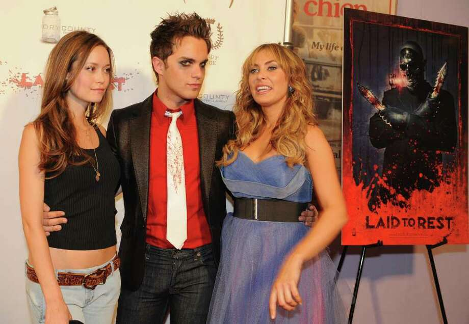 """Actors (L-R) Summer Glau, Thomas Dekker and Bobbi Sue Luther arrive for the premiere of the horror film """"Laid to Rest"""" at the Laemmle's Grande cinema in Los Angeles on April 18, 2009.            AFP PHOTO/Mark RALSTON Photo: AFP/Getty Images"""