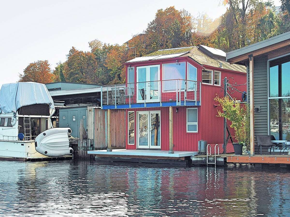 Now that summer seems finally to have arrived in Seattle, it's a good time to look at one of the city's more unique living options -- the floating home. Here are three along Westlake Avenue North, on Lake Union, starting with this home at 2764 Westlake Ave. N., unit G. The end-of-dock home features tons of wood, two three-quarter bathrooms, with towel warmers, and a large master suite created from what had been two bedrooms. It was built in 1978 and is listed for $825,000. (Listing: http://www.cbbain.com/Pages/PropertyDetail.aspx?ListingID=33040208&NAV=1)