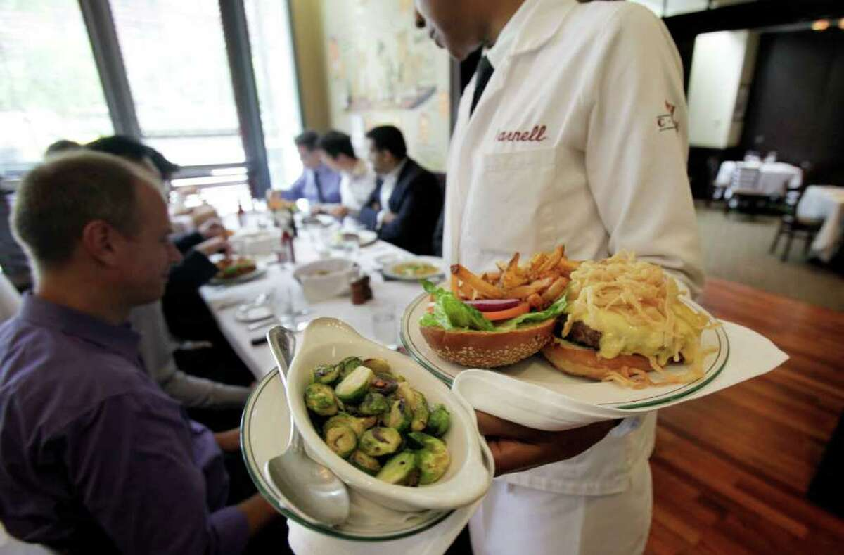 In this June 29, 2011 photo, lunch is served to diners at The Palm restaurant in New York's Tribeca neighborhood. The U.S. service sector, which employs nearly 90 percent of the country?s work force, expanded for a 19th consecutive month in June but at a slower pace than in May. (AP Photo/Richard Drew)