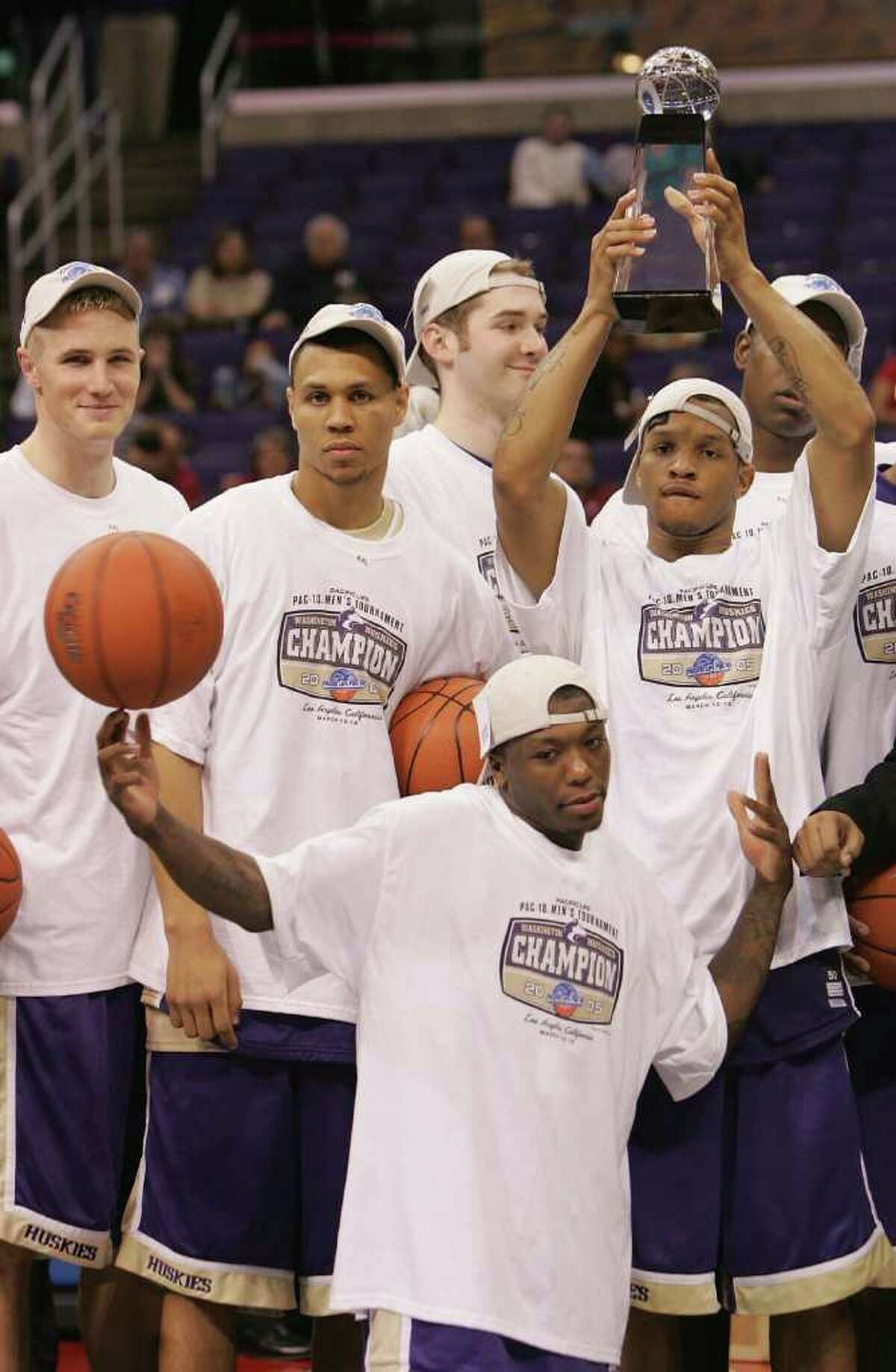20. 2004-05 Huskies basketball Although the March Madness run came to an end too early, the '05 Huskies earned a No. 1 seed, and are remembered as one of the most talented teams in the Lorenzo Romar era. Washington was led by Will Conroy and Nate Robinson, and had key contributors in Bobby Jones and Brandon Roy, compiling a 29-6 record with a 14-4 mark in conference play. The top-seed selection -- the first in program history -- came after the Huskies defeated a talented Arizona team in the Pac-10 tournament championship. After beating Montana and Pacific in the first two rounds of the NCAA Tournament, the Huskies fell to Louisville in the Sweet 16 and finished the season at No. 8 in the AP poll.