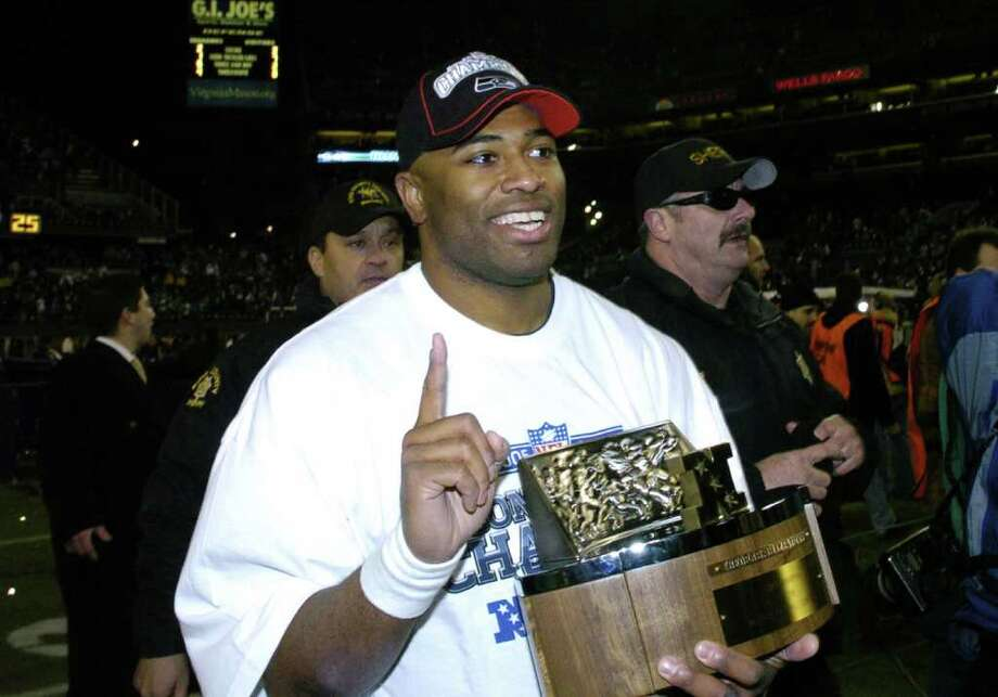 9. 2005 SeahawksBehind a near flawless offensive line, Shaun Alexander set the record for most touchdowns in a season by a running back (broken by LaDainian Tomlinson in '06) and the Seahawks posted a franchise-best 13-3 record -- matched only by the 2013 squad. In the playoffs, sound victories over the Redskins and the Panthers had the Hawks waltzing into the Super Bowl for the first time in franchise history. Although they would lose 21-10, a confession of blown calls from the game's head official Bill Leavy more than four years later left Seattle fans wondering what could have been. Photo: Al Messerschmidt, Getty Images / Getty Images North America