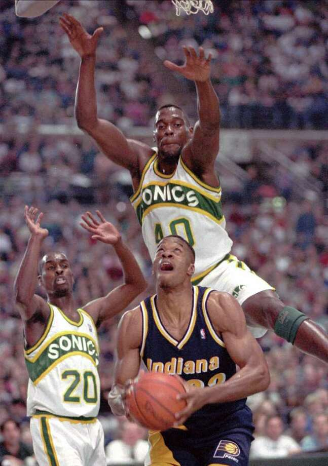 16. 1993-94 SonicsWith a 63-19 record heading into the 1994 playoffs, the Sonics were the top seed in the Western Conference. They would end up making history for the wrong reason, though, becoming the first No. 1 seed to lose to the No. 8 — the Denver Nuggets. The image of Nuggets center Dikembe Mutombo collapsed on the Seattle Coliseum court after Denver upset the Sonics in Game 5 is burnt into the collective memory of Seattle's sports history. Photo: GARY STEWART, Associated Press / AP