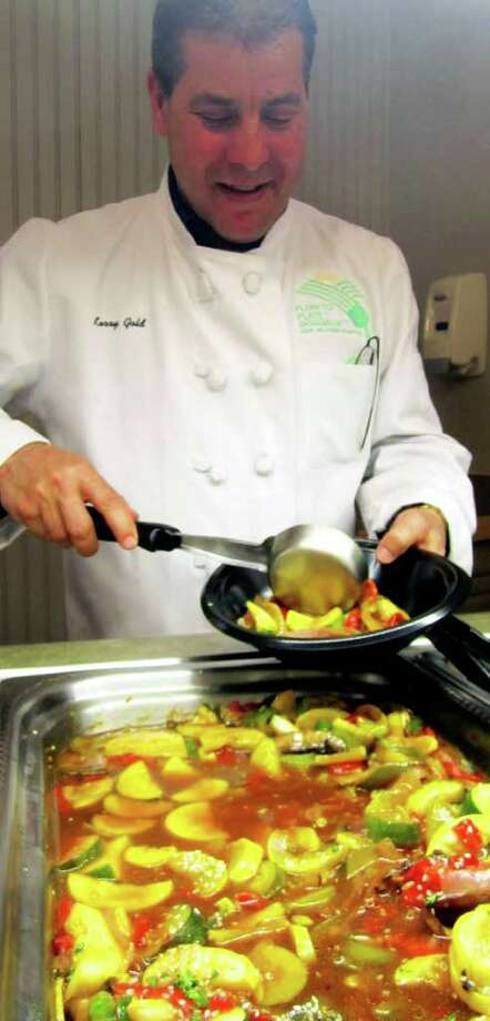 SPECTRUM/Kerry Gold is chef and director for the New Milford Hospital food service, regularly dish out meals that appeal to and are good for staff, patients and patrons from the community. Photo: Norm Cummings / The News-Times