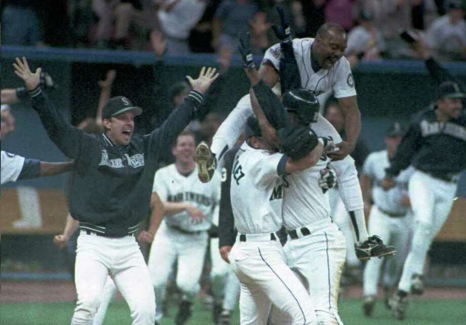 """11. 1995 MarinersTrailing the California Angels by as many as 13 games during the regular season, the Mariners made a magical comeback to end the year and defeated the Angels in a one-game playoff to take the AL West crown. The magic didn't stop there, either. In the postseason for the first time in franchise history, Seattle came back down two games to the Yankees to win the next three. The culmination of the series came in the 11th inning of Game 5, when Edgar Martinez hit """"The Double"""" that scored Ken Griffey Jr. from first base. Cleveland ended up beating the Mariners in the ALCS, four games to two, but the 1995 season is remembered as the one that helped Seattle keep the Mariners, who were in jeopardy of relocating to Tampa Bay. Photo: Michael Moore, AFP/Getty Images / AFP"""