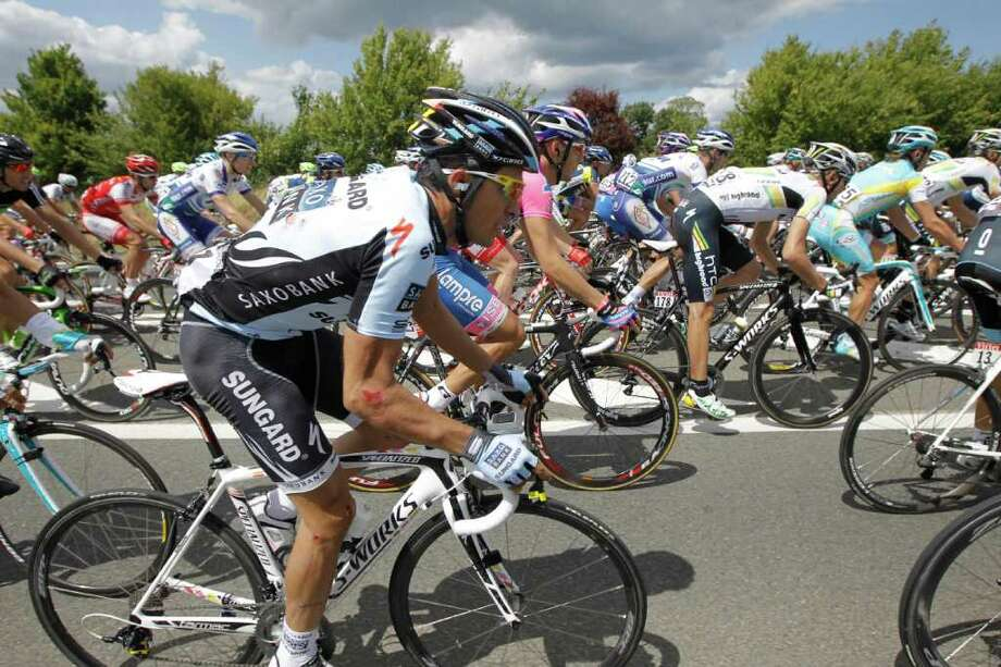 Three-time Tour de France winner Alberto Contador of Spain rides in the pack during the fifth stage of the Tour de France cycling race over 164.5 kilometers (102.2 miles) starting in Carhaix and finishing in Cap Frehel, Brittany, western France, Wednesday July 6, 2011. (AP Photo/Laurent Cipriani) Photo: Laurent Cipriani, STR / AP