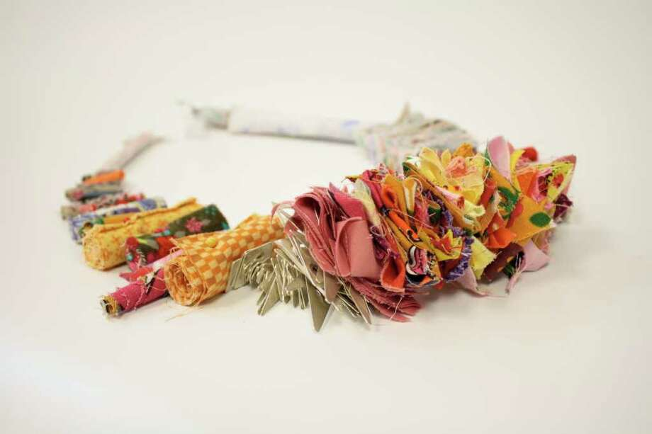 Artist Kristi Rae Wilson has created this necklace from remnant fabrics found in a plastic bag of an anonymous quilter. $2,500.00 at the Center for Contemporary Craft. Photo: Kristi Rae Wilson
