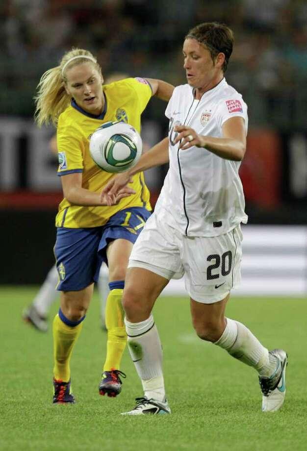 United States' Abby Wambach and Sweden's Lisa Dahlkvist, left, challenge for the ball during the group C match between Sweden and the United States at the Women?s Soccer World Cup in Wolfsburg, Germany, Wednesday, July 6, 2011. (AP Photo/Marcio Jose Sanchez) Photo: Marcio Jose Sanchez, STF / AP