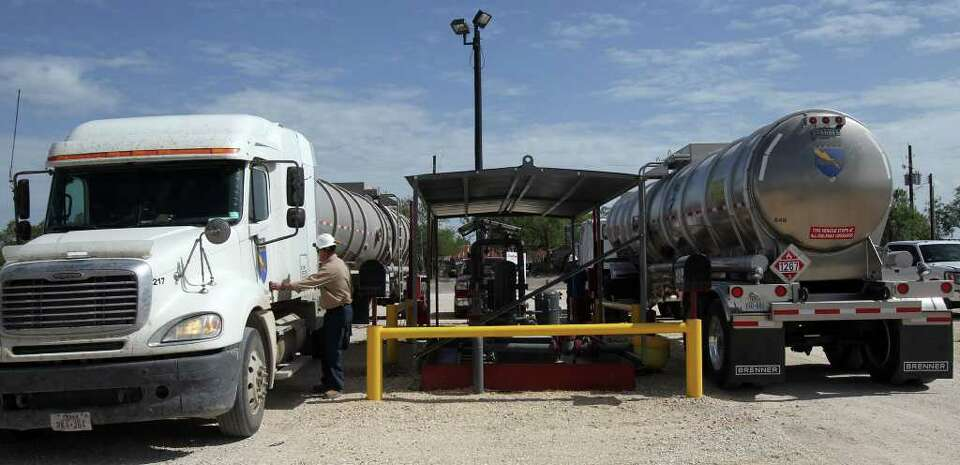 Oil is unloaded from tanker trucks where it will be refined at the Valero Three Rivers refinery i