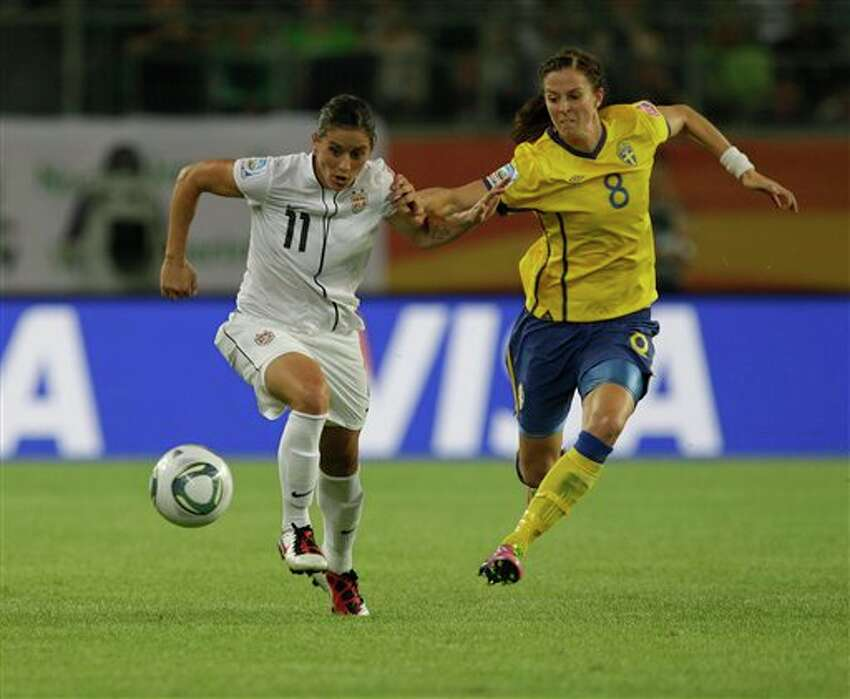 United States' Alex Krieger, left, battles against Sweden's Lotta Schelin during the group C match between Sweden and the United States at the Women�s Soccer World Cup in Wolfsburg, Germany, Wednesday, July 6, 2011. (AP Photo/Marcio Jose Sanchez)