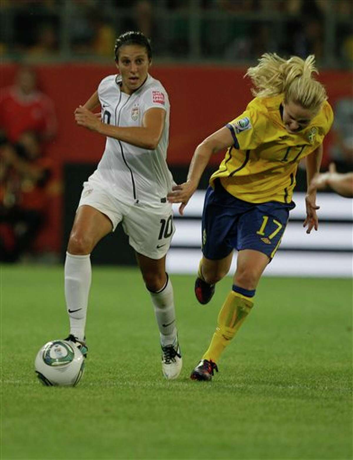 United States' Carli Lloyd, left, in action against Sweden's Lisa Dahlkvist during the group C match between Sweden and the United States at the Women�s Soccer World Cup in Wolfsburg, Germany, Wednesday, July 6, 2011. (AP Photo/Marcio Jose Sanchez)