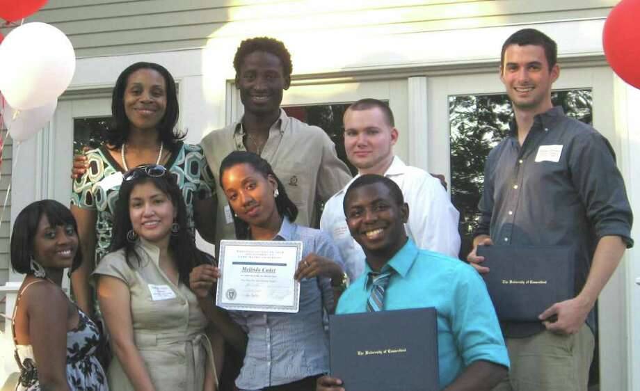 P2P board member Rebecca Wilson with graduates Jordan Lorrius, Christian Burke, Thomas Michael, Fritz Chery, Melinda Cadet, Valeria Lopez Salazar and Keisha Riley. Photo: File Photo