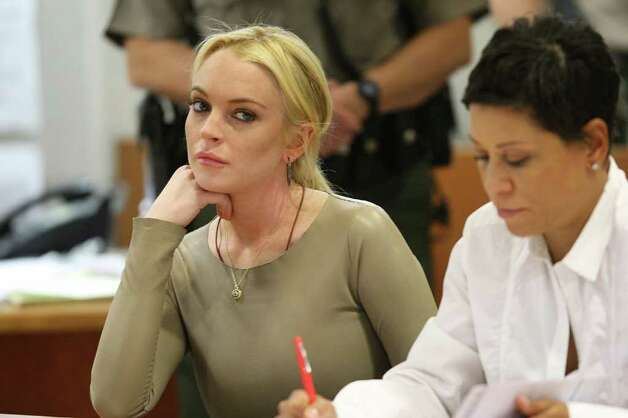 Lindsay Lohan appears with her lawyer Shawn Chapman Holley (R) at a court proceeding at the Airport Superior Court in Los Angeles, California, March 10, 2011. Lohan is charged with a felony count of grand theft of a 2,500 USD necklace allegedly taken from a Venice, California jewelry store.   AFP PHOTO / POOL / David McNew Photo: DAVID MCNEW, AFP/Getty Images / 2011 AFP