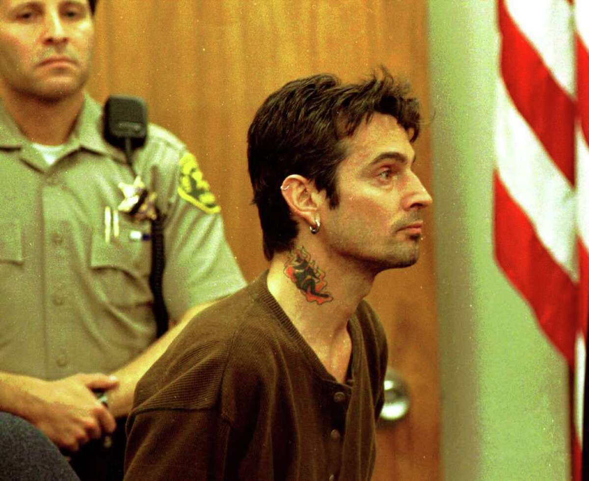 Here Tommy Lee Appears At Malibu Municipal Court accused Of attacking Pamela in 1996.